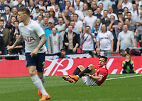 Football - 2017 / 2018 FA Cup - Semi-Final: Manchester United vs. Tottenham Hotspur<br /> <br /> Alexis Sanchez (Manchester United) whinces in pain after turming his ankle early in the game at Wembley Stadium.<br /> <br /> COLORSPORT/DANIEL BEARHAM