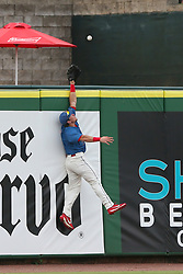 July 17, 2018 - Clearwater, FL, U.S. - TAMPA, FL - JULY 17: Kevin Markham (5) of the Threshers goes up high to in hopes of making the home run robbing catch during the Florida State League game between the Daytona Tortugas and the Clearwater Threshers on July 17, 2018, at Spectrum Field in Clearwater, FL. (Photo by Cliff Welch/Icon Sportswire) (Credit Image: © Cliff Welch/Icon SMI via ZUMA Press)
