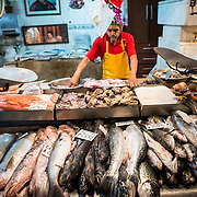 Fresh fish for sale at Mercado Central de Santiago, Chile's central market. The market specializes in seafood, a staple food category of Chilean cuisine. The building is topped with an ornate cast-iron roof.