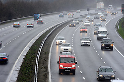 © Licensed to London News Pictures. 18/02/2014<br /> A rainy M25 today (18.02.2014) between Junction 4 for  Orpington and Junction 3 for Swanley in Kent.<br /> Photo credit :Grant Falvey/LNP