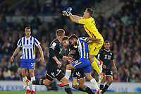 Football - 2021 / 2022 EFL Carabao League Cup - Round Three - Brighton & Hove Albion vs Swansea City - Amex Stadium - Wednesday 22nd September 2021<br /> <br /> Alexis Mac Allister of Brighton receives a knee to the back from Steven Benda of Swansea as the keeper punches clear during the cup match at The Amex Stadium Brighton <br /> <br /> COLORSPORT/Shaun Boggust