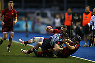 Owen Lane of Cardiff Blues is tackled by Sammy Arnold and Duncan Williams ® of Munster rugby.  Guinness Pro14 rugby match, Cardiff Blues v Munster Rugby at the Cardiff Arms Park in Cardiff, South Wales on Saturday 17th February 2018.<br /> pic by Andrew Orchard, Andrew Orchard sports photography.
