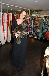 ALICE TEMPERLEY and her dog Monkey at an exhibition of rock photographer Mick Rock's exclusive 'the One and Only' photographic prints held at Notting Hill's newly opened boutique 'One' 30 Ledbury Street, London W11 on 22nd June 2006.<br /><br />NON EXCLUSIVE - WORLD RIGHTS