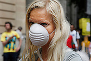 Woman wearing a face mask demonstrating against Chemtrails. The chemtrail conspiracy theory holds that some trails left by aircraft are actually chemical or biological agents deliberately sprayed at high altitudes for a purpose undisclosed to the general public in clandestine programs directed by government officials. As a result of the popularity of the theory, official agencies have received thousands of complaints from people who have demanded an explanation. The existence of chemtrails has been repeatedly denied by government agencies and scientists around the world, who say the trails are normal contrails.