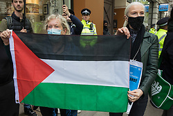 Activists from Palestine Action hold a Palestinian flag at a protest outside the UK headquarters of Elbit Systems, an Israel-based company developing technologies used for military applications including drones, precision guidance, surveillance and intruder-detection systems, on 11th May 2021 in London, United Kingdom. The activists were protesting against the company's presence in the UK and in solidarity with the Palestinian people following attempts at forced evictions of Palestinian families in the Sheikh Jarrah neighbourhood of East Jerusalem, the deployment of Israeli forces against worshippers at the Al-Aqsa mosque during Ramadan and air strikes on Gaza which have killed several children.