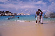 A couple, natives of the British Virgin Islands, share a romantic moment on the beach