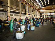 04 NOVEMBER 2016 - BANGKOK, THAILAND:  Volunteers dye clothes black at Krungthai Tractor. About 150 volunteers are working at Krungthai Tractor in Bangkok to dye clothes black for people in mourning following the death of Bhumibol Adulyadej, the King of Thailand. The government declared a one year mourning period, during which Thais are encouraged to wear black and a 30 day mourning period during which Thais are very strongly encouraged to wear black. Furthermore, black is mandatory for official mourning functions, including visits to the Grand Palace and Sanam Luang, the public ceremonial ground across the street from the Palace. The expectation to wear black created a shortage of black clothes in many markets and Thailand's poor couldn't afford what black clothes were still available. Community groups have started dyeing clothes for people who either can't find or can't afford black clothes. The clothes dyeing volunteers at Krungthai Tractor were organized by Thai actress Chompoo Araya A. Hargate and Thai fashion blogger Chavaporn Laohapongchana.     PHOTO BY JACK KURTZ