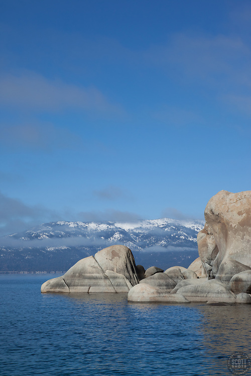 """""""Boulders on Lake Tahoe 15"""" - These boulders and snow covered mountain were photographed from a boat on the East shore of Lake Tahoe."""