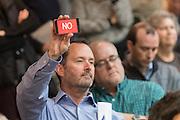 "A member of the audience holds up his phone with the word ""NO"" during a heated discussion with U.S. Sen. Tim Scott and U.S. Rep. Mark Sanford at a town hall meeting February 18, 2017 in Mount Pleasant, South Carolina. Hundreds of concerned residents turned up for the meeting to address their opposition to President Donald Trump during a vocal meeting held by U.S. Rep. Mark Sanford and Senator Tim Scott."