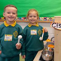 Dara Ó Cróinin and Cloe Ní Ghriofa play together during their first day of school at Gaelscoil Mhíchíl Cíosóg, Inis