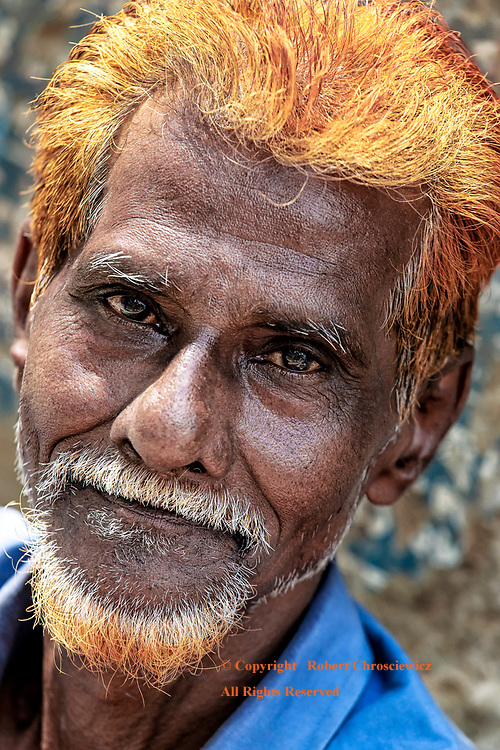 Fashionably Orange: A man with orange hair and beard is caught in a portrait, Dhaka Bangladesh.
