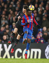 Arsenal's Laurent Koscielny and Crystal Palace's Christian Benteke (right) battle for the ball during the Premier League match at Selhurst Park, London.