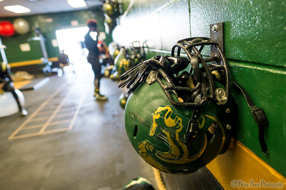 Helmets of the Monterey Trail Mustangs hang in the weight room before the game as the Monterey Trail Mustangs host the Sheldon High School Huskies Friday Sep 23, 2016.<br /> photo by Brian Baer