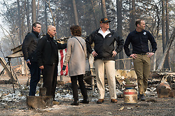 November 17, 2018 - Paradise, California, U.S. - Governor elect GAVIN NEWSON, Governor JERRY BROWN, Paradise mayor JODY JONES, President DONALD TRUMP, and FEMA Director BROCK LONG, tour the Skyway Villa Mobile Home and RV Park with Gov. Jerry Brown during his visit of the Camp Fire in Paradise. The Camp Fire in Northern California has become the nation's deadliest wildfire in a century and has killed at least 63 people and left more than 1000 still missing. (Credit Image: © Paul Kitagaki Jr./ZUMA Wire)