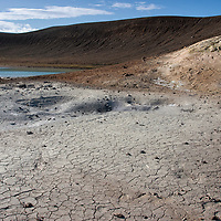 """Dry soil near the geothermal steam pipeline. <br /> The first homemade """"pipeline"""" was installed by a farmer in 1907 which conducted steam into his house. Before that, in 1904, the first electricity producing hydropower plant was built near Reykjavic."""