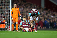 Andy Carroll of West Ham United talks to Mark Noble (on ground) the West Ham United captain after he is not awarded a penalty. Barclays Premier league match, West Ham Utd v Stoke city at the Boleyn Ground, Upton Park  in London on Saturday 12th December 2015.<br /> pic by John Patrick Fletcher, Andrew Orchard sports photography.