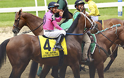 June 9, 2018 - Elmont, New York, U.S - Hall of Fame jockey VICTOR ESPINOZA rode CONQUEST TSUNAMI in the Jaipur Invitational on Belmont Stakes day on June 9, 2018 at Belmont Park. Here, Espinoza acknowledges the cheers of the crowd during the post parade. Conquest Tsunami and Espinoza took second place to Disco Partner (Irad Ortiz Jr.). Later that day, in the Belmont Stakes, Mike Smith aboard Justify became the first Triple Crown winner since Victor Espinoza and American Pharoah in 2015. (Credit Image: © Staton Rabin via ZUMA Wire)