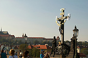 Czeck Republic - Prague, Crucifix and stautes line the Charles Bridge