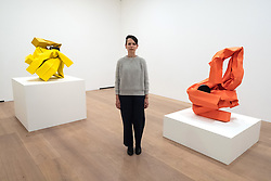 © Licensed to London News Pictures. 07/06/2018. London, UK. Artist CAROL BOVE poses next to her work titled Cutting Corners, 2018 (L) and Rich Mom, 2018 (R) showing as part of an exhibition at the David Zwirner gallery. Photo credit: Ray Tang/LNP