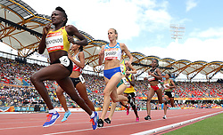 Scotland's Lynsey Sharp (centre) in action during heat 3 of the Women's 800m with Uganda's Winnie Nanyondo, at the Carrara Stadium during day eight of the 2018 Commonwealth Games in the Gold Coast, Australia.
