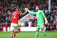Nottingham Forest defender Eric Lichaj (2) scores a goal and celebrates with goalkeeper Jordan Smith, 2-0,  during the EFL Sky Bet Championship match between Nottingham Forest and Burton Albion at the City Ground, Nottingham, England on 21 October 2017. Photo by John Potts.