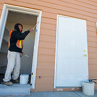 101513       Brian Leddy<br /> A construction worker who did not wish to give his name paints a doorway at a home in Crownpoint Tuesday. The home is one of several that were completely remodeled by the Navajo Housing Authority.