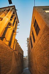 Narrow street in original historic Al Fahidi district , al Bastakiya , in Dubai, United Arab Emirates