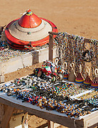 Souvenirs for sale on the banks of the Bani River, next to queue waiting board the car ferry, near Djenné, Mali