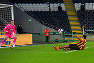 Mallik Wilks of Hull City slides in for shot punt on goal but goes high over the bar during the EFL Sky Bet League 1 match between Hull City and Swindon Town at the KCOM Stadium, Kingston upon Hull, England on 30 January 2021.