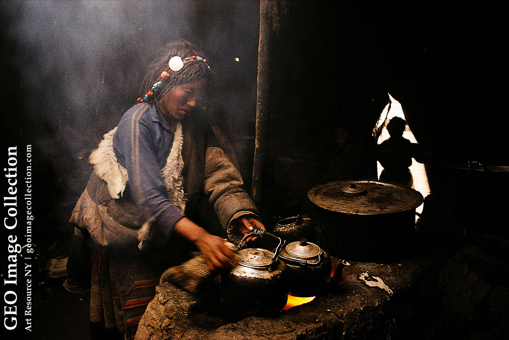 Making tea in a summer camp near the source of the Mekong river. Qinghai, China.