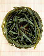 nest of curly green spinach flavored spaghetti