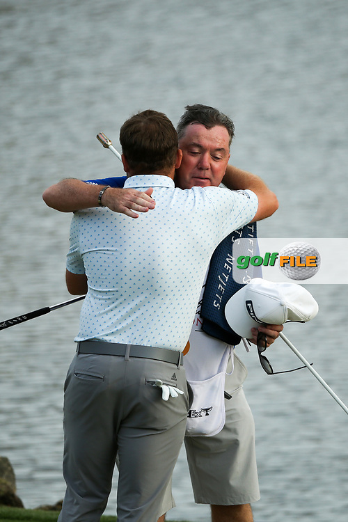 Tyrrell Hatton (ENG) and caddy Michael Donaghy on the 18th during the final round of the Arnold Palmer Invitational presented by Mastercard, Bay Hill, Orlando, Florida, USA. 08/03/2020.<br /> Picture: Golffile | Scott Halleran<br /> <br /> <br /> All photo usage must carry mandatory copyright credit (© Golffile | Scott Halleran)