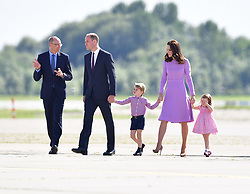 Prince George and Princess Charlotte walk with their parents, the Duke and Duchess of Cambridge, as they visit Airbus in Hamburg, Germany.