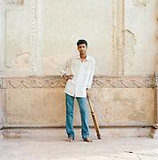 Portrait of young man with cricket bat, Lucknow, Uttar Pradesh, India
