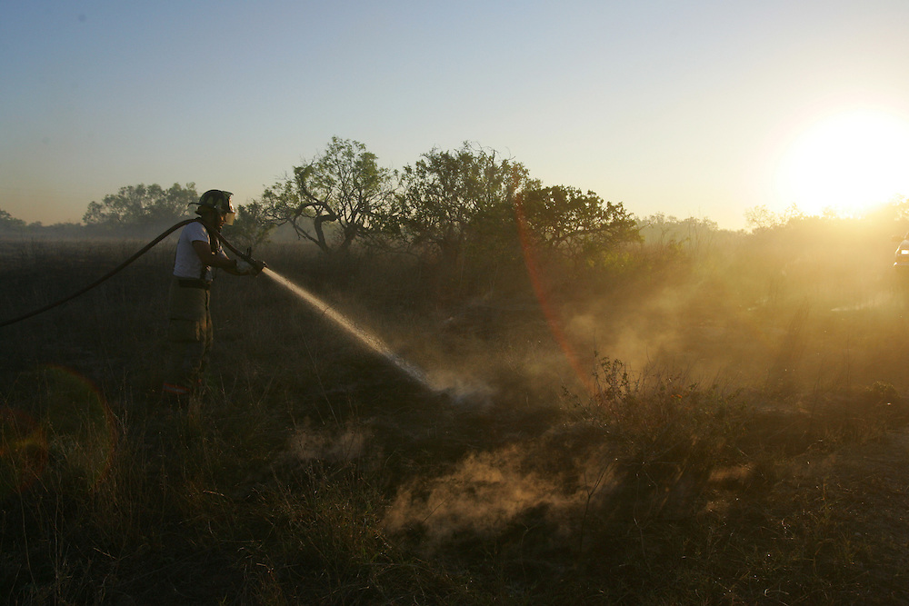 San Manuel, TX - 19 Mar 2008 -.Edcouch Fire Department firefighter Johnny Gonzalez extinguishes hot spots on a ranch north of FM 1017 on Wednesday morning..Photo by Alex Jones / ajones@themonitor.com