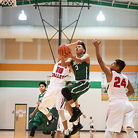 Cordell Platero (3) drives to the basket for Thoreau in their game against Hatch Valley, Saturday, Dec. 15 in the Wingate Holiday Classic, at Wingate High School.