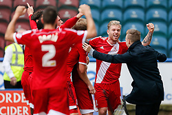 Adam Clayton of Middlesbrough celebrates with a supporter after Grant Leadbitter of Middlesbrough scores a penalty to win the match 1-2 - Photo mandatory by-line: Rogan Thomson/JMP - 07966 386802 - 13/09/2014 - SPORT - FOOTBALL - Huddersfield, England - The John Smith's Stadium - Huddersfield town v Middlesbrough - Sky Bet Championship.