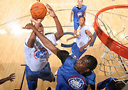 C/F Daniel Orton (Oklahoma City, OK / Bishop McGuinness) is fouled by C/F Xavier Gibson (Dothan, AL / Northview) during the NBA Top 100 Camp held Friday June 22, 2007 at the John Paul Jones arena in Charlottesville, Va. (Photo/Andrew Shurtleff)