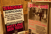Terrorism posters from the 1970's inside an exhibition about surveillance and security at the Imperial War Museum, London.