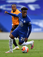 Football - 2019 / 2020 Premier League - Chelsea vs. Wolverhampton Wanderers<br /> <br /> Chelsea's Callum Hudson-Odoi holds off the challenge from Wolverhampton Wanderers' Adama Traore, at Stamford Bridge.<br /> <br /> COLORSPORT/ASHLEY WESTERN
