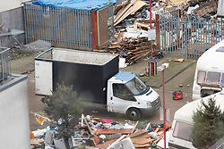© Licensed to London News Pictures. 03/02/2020. London, UK. A group of travellers have occupied vacant land in Alperton, North West London. A truck is seen on the property with rubbish and then seen leaving after dumping the rubbish. It is reported the land owners have applied to the court for the evection of the travellers.  Photo credit: London News Pictures