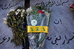 Flowers from Hezbollah and others sit on the grave of the Al-Akhrass family, members of which were killed in the war between Hezbollah and Israel, Aytaroun, Southern Lebanon, Oct. 23, 2006.