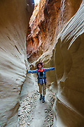 Dry Fork Coyote Gulch in Grand Staircase-Escalante National Monument, Utah, USA. We hiked from the Lower Trailhead of Dry Fork Coyote Gulch to the slot canyons of Peekaboo Gulch and Spooky Gulch, looping back via Dry Fork (5.7 miles round trip) to a bench trail. (Instead, I recommend starting at the Upper Trailhead, to cover similar mileage, to further transit the coolness of Dry Fork, and to save 10 minutes of side road driving time.) To license this Copyright photo, please inquire at PhotoSeek.com.