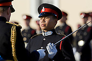 Officer cadet is presented with sword of honour at Passing Out graduation parade at Sandhurst Military Academy