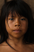 Huaorani Indian child<br /> Bameno Community. Yasuni National Park.<br /> Amazon rainforest, ECUADOR.  South America<br /> This Indian tribe were basically uncontacted until 1956 when missionaries from the Summer Institute of Linguistics made contact with them. However there are still some groups from the tribe that remain uncontacted.  They are known as the Tagaeri & Taromenane. Traditionally these Indians were very hostile and killed many people who tried to enter into their territory. Their territory is in the Yasuni National Park which is now also being exploited for oil.