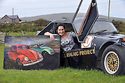 20-9-2012: Marta Revillas with her paintings of cars from her exhibition 'I Love Petrol' which is on show in a local garage in Ballinskelligs, County Kerry as part of the Cill Rialaigh 21st celebration art weekend which is taking place over this weekend..Picture by Don MacMonagle