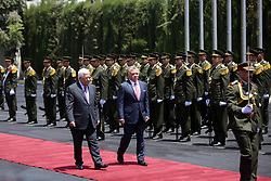 August 7, 2017 - Ramallah, West Bank, Palestinian Territory - Jordan's KING ABDULLAH II and Palestinian president MAHMUD ABBAS observe the honor guard during a visit in the West Bank city of Ramallah. Jordan's King began a rare visit to the occupied West Bank to meet with the Palestinian President, amid shared tensions with Israel over a flashpoint Jerusalem holy site.  (Credit Image: © Shadi Hatem/APA Images via ZUMA Wire)