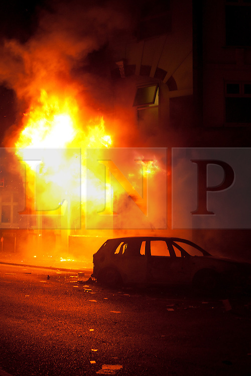 © Licensed to London News Pictures. 08/08/2011. LONDON, UK. Fire spreads to a building on London Road in Croydon after rioters set alight to a shop further down the road. The fire took place as Croydon was hit during a third night of violence across London which also spread to at least three other cities in the United Kingdom. Photo credit: Matt Cetti-Roberts/LNP