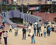 9905-N03. opening of Pioneer Courthouse Square in Portland, people looking down at their bricks. April 6, 1984.