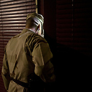 A Camp 6 guard looks into one of the pods where detainees are held at the Guantanamo Bay Detention Facility in Guantanamo Bay, Cuba. The detainees held in this facility were captured after the attacks on the United States on September 11, 2001. In 2009 US president Barack Obama ordered the closure of the facility, yet to date it still remains open. These Photos were reviewed by military officials before release.